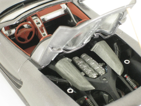 Engine cover opened to show 12 cylinder engine in Porsche Carrera GT model car from Tamiya